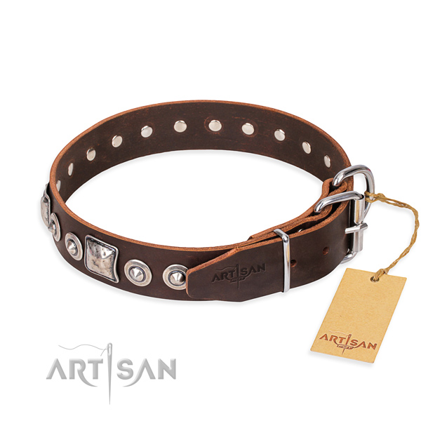Natural genuine leather dog collar made of soft to touch material with reliable adornments
